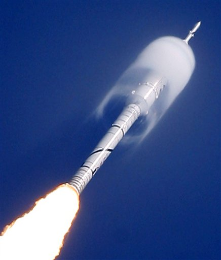 A cone of moisture surrounds part of the Ares I-X rocket during lift off Wednesday, Oct. 28, 2009, on a sub-orbital test flight from the Kennedy Space Center's Launch Pad 39-B in Cape Canaveral, Fla. (AP Photo/Chris O'Meara)
